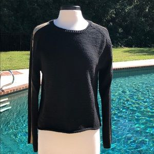 Black and gold sweater with ice jeans down sleeve